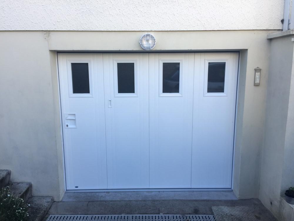 socodime r alisation d 39 une porte de garage lat rale manuelle pr s de saint l dans la manche. Black Bedroom Furniture Sets. Home Design Ideas