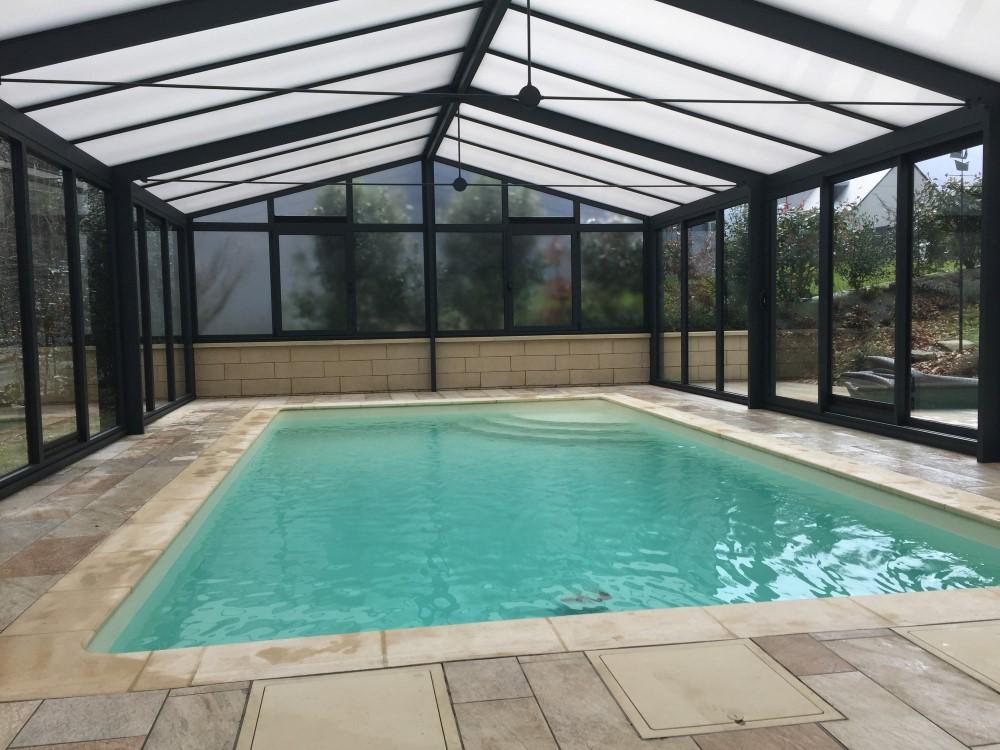 Installation d 39 une v randa pour abriter une piscine sur for Piscine dans la manche